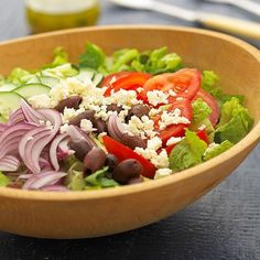 Tomatoes, cucumbers, onion, and olives form a fresh foursome common in Greek salads. A homemade Greek vinaigrette makes this Mediterranean recipe even more authentic.