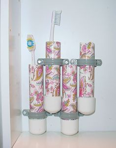 """CUPBOARD TOOTHBRUSH STORAGE. 3/4"""" pvc pipe, add end caps. Cover pipe section with duct tape. Use electrical brackets to mount."""