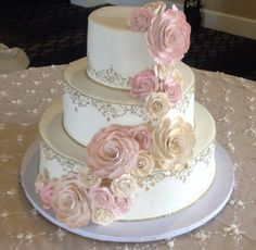 Look at this romantic, whimsical cake we created for a lovely bride. Torrance bakery can make your wedding cake dreams come true!! #Torrance Bakery #weddingwednesday #blushandgold #roses #weddingstyle #weddingcake