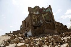 A boy walks by a house destroyed in an airstrike carried out by a Saudi-led coalition warplane in 2018 in Sana'a, Yemen. Saudi Arabia Culture, Foreign Policy, Mount Rushmore, Washington, War, Mountains, Travel, Facts, Money