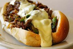SLOW COOKER PHILLY CHEESE STEAK SANDWICHES Recipe Lunch and Snacks, Main Dishes with round steaks, green pepper, onions, beef stock, garlic salt, black pepper, italian salad dressing mix, hoagie buns, french bread, cheese slices