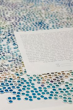 The CIRCLES papercut ketubah multilayer with giclee print background