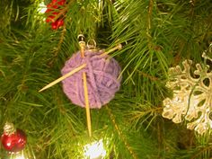 """knitty ornament - with tutorial. Depending on size of ball, you could use other things for the """"needles"""""""