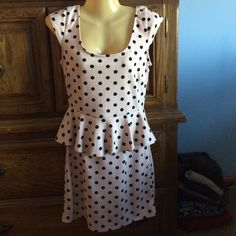Accepting OffersPolka dot peplum dress Worn once so in great condition. Light pink and black polka dot dress. Scoopneck with peplum at waist Speechless Dresses Mini