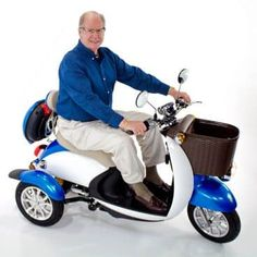 Electric Mobility scooter also known as travel scooters in the UK have become common on our streets. Transportation Technology, Third Wheel, Electric Scooter, Electric Chair, Rear Seat, Baby Strollers, Mobility Scooters, Sports, Blue