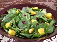 Spinach Salad with Mangos, Dried Cranberries and Chocolate Vinaigrette recipe from Sandra Lee via Food Network