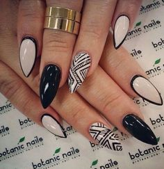 Not down with the pointy nails, but the black outlined nude nails are super cool!
