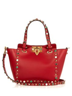 Valentino looks for fresh ways to upscale its accessories for the new season. This Rockstud Rolling bag is trimmed with the label's hallmark gold-tone pyramid studs as well as an array of multicoloured gemstones. Carry it during the day across the body of a paintbox-bright dress.