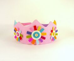 Felt Princess Crown -- Perfect for Birthdays or Dress-up -- Light Pink Organic Canvas Crown with Wool Felt Rainbow Flower by CleoAndPoppy on Etsy https://www.etsy.com/listing/156177519/felt-princess-crown-perfect-for