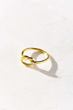 A simple knotted ring.   29 Inexpensive Pieces Of Dainty Jewelry You'll Wear Every Day