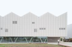 Wulf Architekten creates school sports centre with zigzag roof informed by the Alps Public Architecture, Architecture Plan, Concrete Cover, Masterplan, Concrete Staircase, Glazed Walls, Sport Hall, Exposed Concrete, Shed Roof