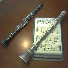"Clarinet Birthday cake! Fondest covered Rice-Crispy treat on a skewer, piped ""Happy Birthy"" song in notes on the cake."