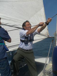 BMC Director, Rich Eisenberg, teaching the basics of sail trim to a group of young sailors on BMC's 34' racing catamaran, Taco the Town!