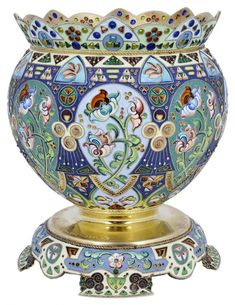 A RUSSIAN ENAMEL AND SILVER-GILT BOWL, 11TH ARTEL, MOSCOW, 1908-1917 the shaped rim with plique-à-jour enamelling, the almost spherical body with cloisonné enamelled panels of flowers and geometric patterning, the pedestal engraved with an inscription, the shaped foot rim with further cloisonné enamelling, 875 standard 11.5cm high.