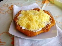 """Egyszerű strandos lángos - Hungarian speciality """"langosh"""" with sour cream and cheese Vegetarian Main Course, Hungarian Recipes, Hungarian Food, Love Eat, Sour Cream, Baked Potato, Foodies, Food And Drink, Yummy Food"""