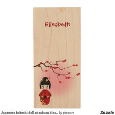 Japanese kokeshi doll at sakura blossoms wood flash drive