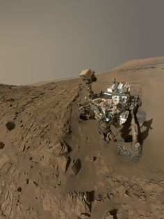 """NASA's Curiosity Mars rover used the camera at the end of its arm in April and May 2014 to take dozens of component images combined into this self-portrait where the rover drilled into a sandstone target called """"Windjana."""""""