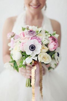 Anemone bouquet styles are a hot trend right now with their black centers and beautiful white petals. Check out some gorgeous wedding bouquets here!