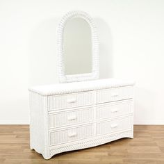 This cottage chic dresser is featured in a woven wicker with a fresh white paint finish. This long dresser has 6 drawers, latticework accents and a curved top mirror. Perfect for additional clothing storage! #americantraditional #dressers #longdresser #sandiegovintage #vintagefurniture