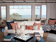 Contemporary Retreat /   Designer Darci Goodman infuses the homeowners' love for the ocean and their passion for modernism when designing this contemporary seaside retreat. Using traditional hues of white and navy blue as the primar...more