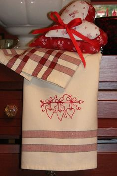 Remember your Valentine with a pretty RedWork Red Stripe Tea Towel embroidered with a string of hearts.