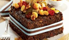 Ina Paarman's mixture is so moist that it can double as a Christmas pudding, so bake both from one mix! Soaking the fruit in advance speeds up the ripening of the cake, so it can be enjoyed as early as the day after baking. Decorate with assorted nuts and dried fruits held together with apricot jam.