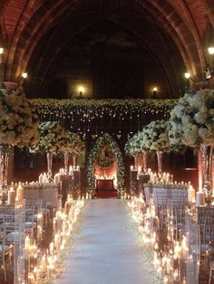 Beautiful aisle sparkling with candlelight