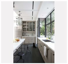 O so D.  Industrial look to windows, mixed with historical looking kitchen