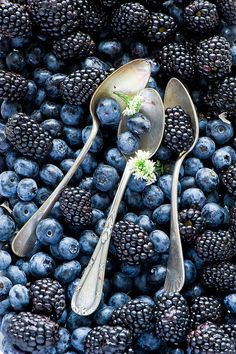 Blueberries, blackberries, and spoons