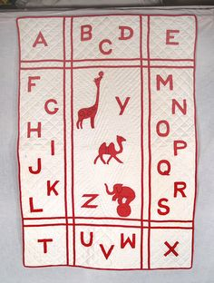 Very cute red and white alphabet quilt