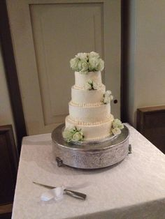 Four Tiered Wedding Cake Comprising Of Citrus Flavored Sponge And Vanilla Swiss Buttercream So
