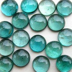 glass flat marbles of aqua