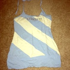 Bebe Halter Top I'm selling this Bebe blue and white striped halter top. Ties at the top. Built in bra. Stretchy and very flattering. Bebe spelled out in gems. In great condition. bebe Tops