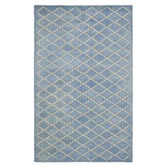 Anchor your living room seating group or define a space in your master suite with this hand-tufted wool rug, showcasing a trellis motif in a blue grey hue.
