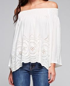 Smocked off the shoulder top with eyelet detail at the waist. Bell sleeves. Stylist tip: Wear with skinny jeans, heels and layer on long necklaces for a perfect