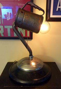 Repurposed Ford hubcap lamp with oil filler shade