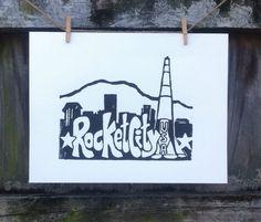 Original hand printed linocut block print of by 30SilentMockingbirds, $15.00 Rocket City USA, Huntsville Alabama. With skyline. For sale on Etsy.