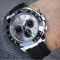 Rolex Cosmograph Daytona with a Silver Dial. Presenting the finest Men's Watches collection inspiration sharing. Best gift for men in fine suits. Rolex Submariner, Rolex Cosmograph Daytona, Rolex Daytona, Rolex Watches For Men, Seiko Watches, Luxury Watches For Men, Rolex Oyster Perpetual, Stylish Watches, Cool Watches