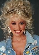 Dolly Parton.  Love her story, music and heart.....