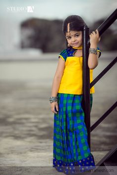 Pattu pavadai is the perfect choice of traditional wear for kids and its always trending!   As much as we love grandeur, we love simplicity and we are sure that your kid will look ravishing in this colour combination!   Click here to buy it online - http://www.anyaonline.in/product.aspx?produid=AK0077  Shot by Amar Ramesh Photography