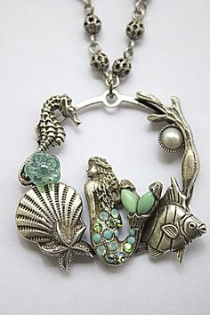 Mermaid Hoop Necklace made with varicite and turquoise semi-precious cabochons, light turquoise, turquoise, AB peridots Swarovski Crystal. 18 inches Long. Made with America