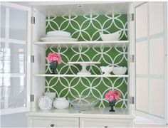 Wow... great idea! Cover foam core board with fun paper or wallpaper and cut to fit the back of a china cabinet - when your bored of the look, take out the foam core or recover with a new look!