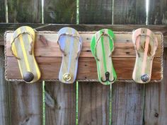 Thong (flip flop) towel holder made from wood and rope.. cute for next to a pool area :)  <3  https://www.etsy.com/listing/246429523/flip-flop-towel-holder-outdoor-towel
