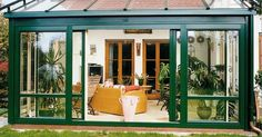 Fresh Small Sunroom Porch With Barn Outdoor Living Room Mixed Green And White Exterior Sliding Doors