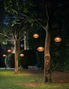 When designing your backyard, don't forget to carefully plan your lighting as well. Get great ideas for your backyard oasis here with our landscape lighting design ideas. Outdoor Tree Lighting, Outdoor Hanging Lights, Outdoor Trees, Backyard Lighting, Outdoor Light Fixtures, Lighting Ideas, Lighting Design, Hanging Tree Lights, Battery Operated Outdoor Lights
