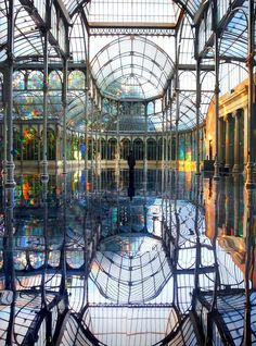 "Reflective Palace is an enchanting art installation from 2006. Titled, ""To Breathe – A Mirror Woman"", Korean artist Kim Sooja transformed the Palacio de Cristal in Madrid one summer. Using the original architectural structure, Sooja reconstructed the interior of the 22-metre high building entirely, placing mirrors on the floor and coating windows in a translucent diffraction film."