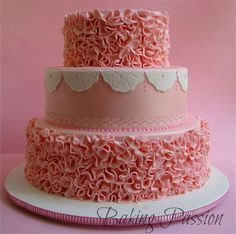 Layers of Pink Ruffles on Three-Tiered Cake