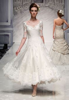Vintage chic. This is an ankle length lace wedding dress with a V-neck and elbow length sleeves.