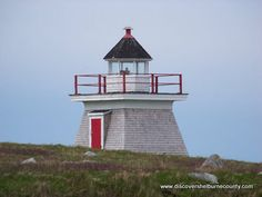 STODDARD ISLAND (EMERALD ISLE) LIGHTHOUSE    Located in Shag Harbour, NS, this square, wooden tower was built in 1877.  Standing at 21 feet tall the station was destaffed in 1993. Lighthouse Trails, Emerald Isle, Light House, Nova Scotia, All Over The World, Seattle Skyline, Nautical, Tower, Florida