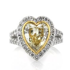Feel like royalty with this mouth watering fancy yellow heart shaped diamond engagement ring. The three and a quarter carat heart shaped center diamond is EG. Heart Shaped Diamond Ring, Heart Shaped Engagement Rings, Heart Wedding Rings, Yellow Diamond Rings, Round Diamond Ring, Diamond Engagement Rings, Heart Rings, Yellow Diamonds, Designer Engagement Rings